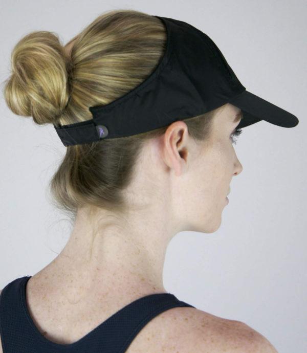 black microfiber hat with hair in bun
